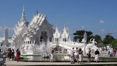 Tourists at Wat Rong Khun, the White Temple, in Chiang Rai, Thailand Stock Footage