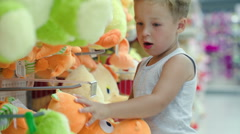 Boy choosing toy in the shop Stock Footage