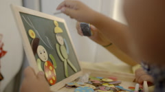 Education of a child with game and drawing Stock Footage