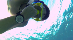 Snorkler clearing his ears 80 Stock Footage