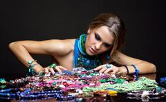 brunette woman and heap of bijouterie - stock photo