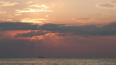 Timelapse of sunset over sea and sailing ship Stock Footage
