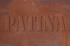 Rusted metal plate with a font in relief Stock Photos