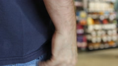 Man Texting in Grocery Store Taking Phone out of Pocket CU Stock Footage