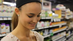 Young Woman Texting on Phone in Grocery Store - Face CU - stock footage