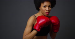 Black woman boxer punching towards camera Stock Footage