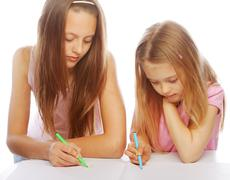 Sisters draw on the album Stock Photos