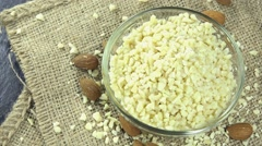 Portion of minced almonds (loopable) Stock Footage