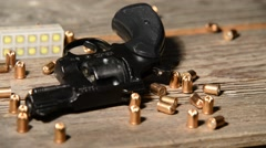 Stock Video Footage of detail of revolver with cartridges, zoom in