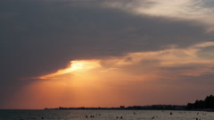 Timelapse of sunset in cloudy sky - stock footage