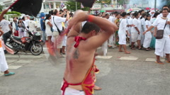 BLOOD RELIGION RITUAL SELF SACRIFICE FAITH SUFFERING AXE Stock Footage