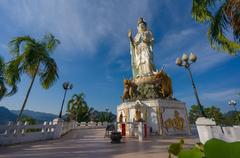 Place of worship in front of statue of guan yin / kuan im goddess in wat bang Stock Photos