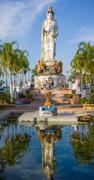 place of worship in front of statue of guan yin / kuan im goddess and pool in - stock photo