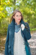 Attractive fashionable woman outdoors in autumn - stock photo