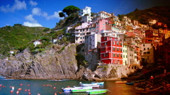 View of one of the famous Cinque Terre, Riomaggiore, time lapse Stock Footage