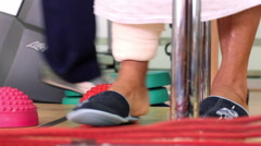 Stock Video Footage of Mexico, 2014: CLOSE UP-HANDHELD SHOT. Feet exercises in a rehab clinic.