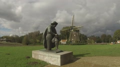 Stock Video Footage of Statue of Rembrandt and Windmill on the Amstel