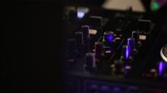 DJ uses professional mix controller Stock Footage