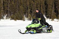 snowmobile in winter - stock photo
