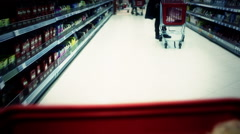 Moving shopping cart in big market - stock footage