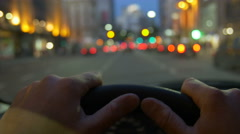 Driving a car through the city POV , hand on steering wheel. Dusk. 4k Stock Footage