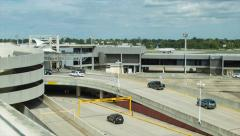 Vehicles Entering New Orleans Airport MSY Stock Footage