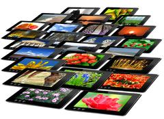 black tablets with motley pictures isolated - stock photo