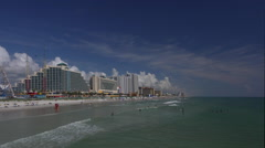 Ocean surf and resorts seen from Daytona pier Stock Footage