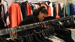 Young Black Woman Shopping in Clothing Store Stock Footage