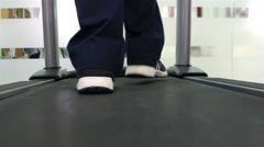 Mexico, 2014: CLOSE UP-HANDHELD. Feet walking in a runner machine. Stock Footage
