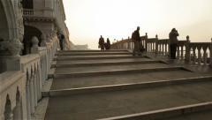 People on old stone bridge at morning Stock Footage