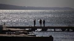 Talking at the pier in Selimpaşa - Marmara Sea Stock Footage