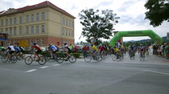 Cyclists riding in to corner wide shot Stock Footage