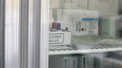 CLOSE UP-HANDHELD SHOT. Febrile reactions introduced in a refrigerator. Stock Footage