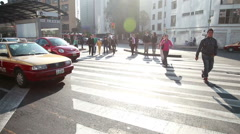 Mexico City, 2014: FULL SHOT-HANDHELD-DOLLY IN. People croosing the street. Stock Footage
