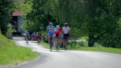 Pushing bicycle uphill Stock Footage