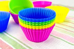 Molds for cupcakes on fabric Stock Photos