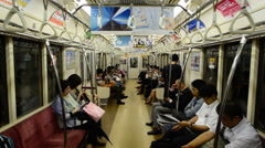 Time Lapse of Train Passengers Riding a Busy Subway Car - Tokyo Metro Rail - stock footage