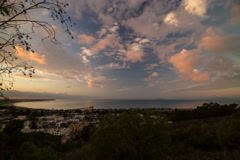 5k Time lapse, Dawn looking over beach city with pink clouds Stock Footage