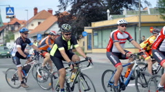 Cyclists passing the camera Stock Footage