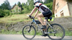 Riding beside cyclist in wide shot Stock Footage