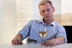 Man looking for a glass of wine Stock Photos