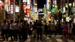 Time-lapse night view of people walking around Kabukicho area in Shinjuku - stock footage
