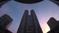 Time-lapse day to night view of Tokyo Metropolitan Office Building in Shinjuku - stock footage