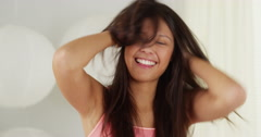 Hispanic woman being silly and messing with hair Stock Footage