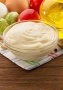 mayonnaise sauce in bowl on wood - stock photo