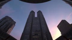 Time-lapse day to night pan up view of Tokyo Metropolitan Office Building - stock footage