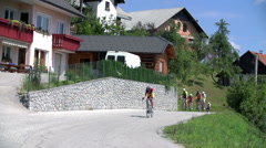 Bikers riding past countryside houses Stock Footage
