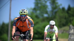 Cyclist with helmet speeding in slow motion Stock Footage