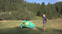 HD. Tourist in vacation, in camping site,  make physical exercises. Stock Footage